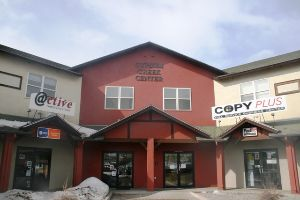 A red building with the words Gypsum Creek Center at the top.